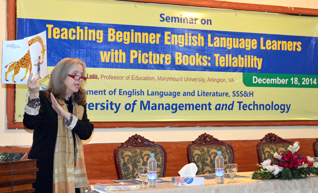 Dr. Ana Lado addressing seminar on Teaching Beginner English Language Learners with picture book: Tellability